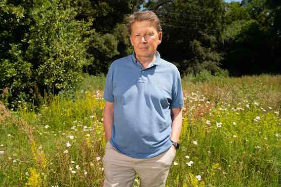 Bill Turnbull stoned in a field